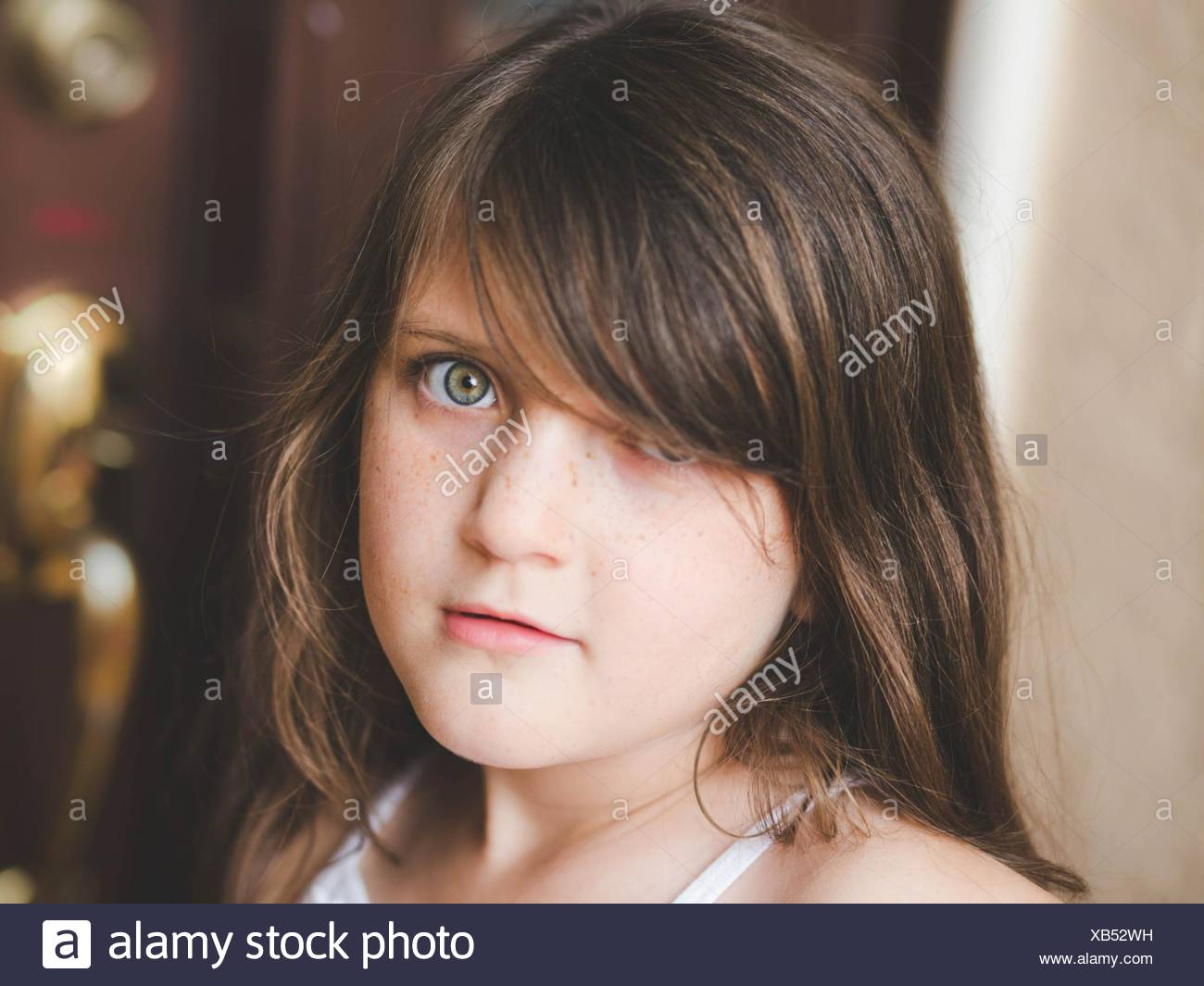 Adolescent pré girl looking at Camera Photo Stock