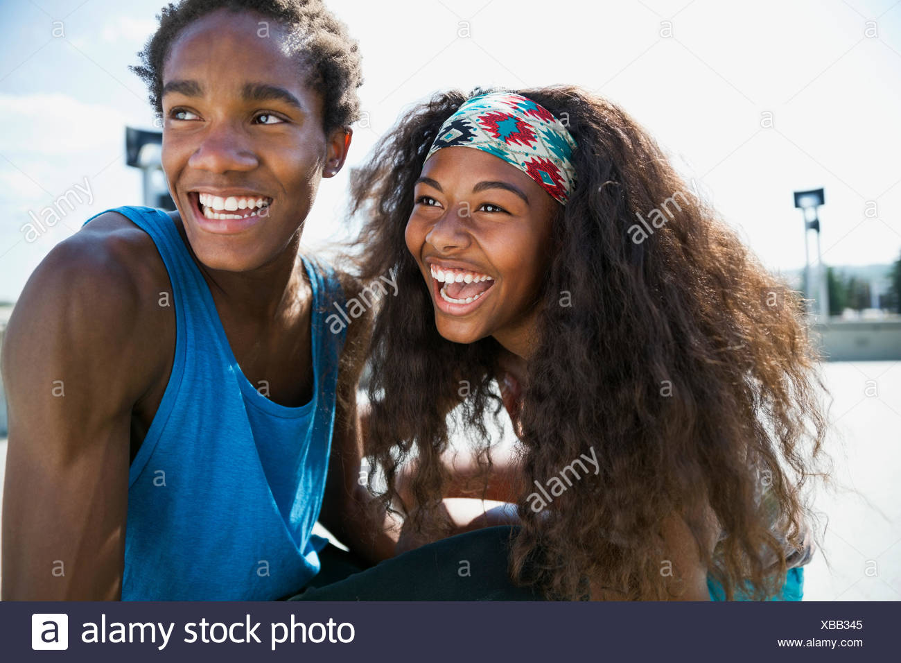 Teenage couple laughing outdoors Photo Stock