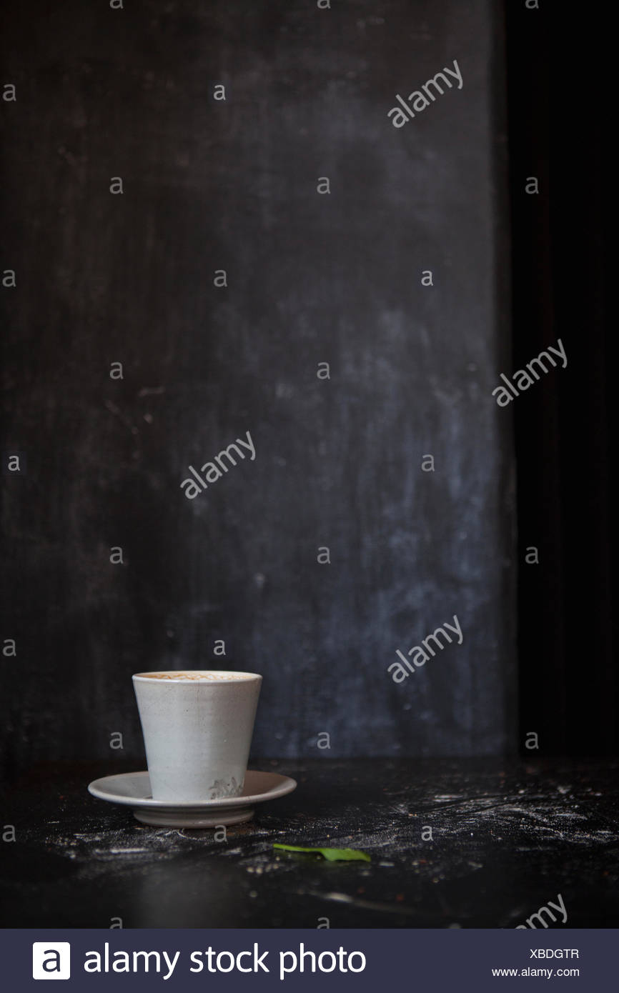 Coffee cup in dark room Photo Stock