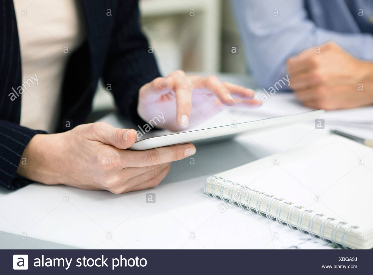 Businesswoman using digital tablet, cropped Photo Stock