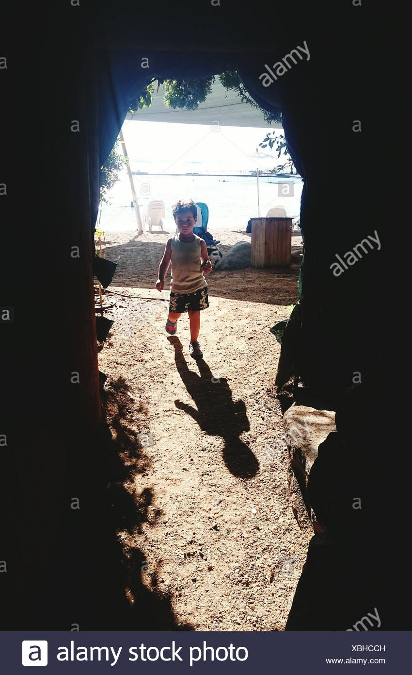 Boy Walking in Field Photo Stock