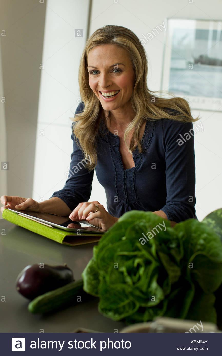 Mature Woman using digital tablet Photo Stock
