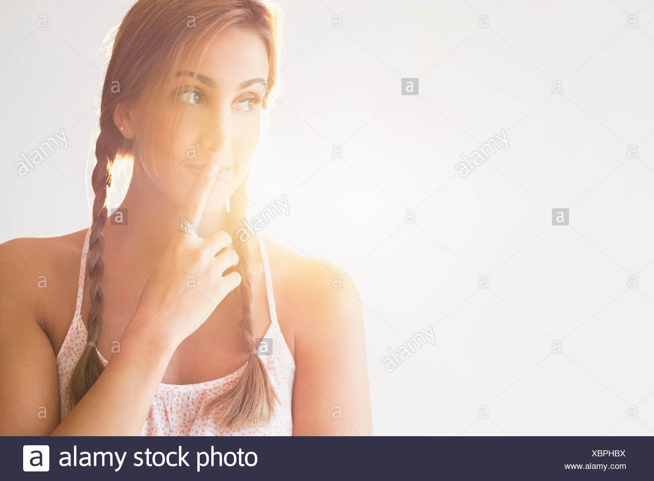 Portrait of young woman in studio Photo Stock