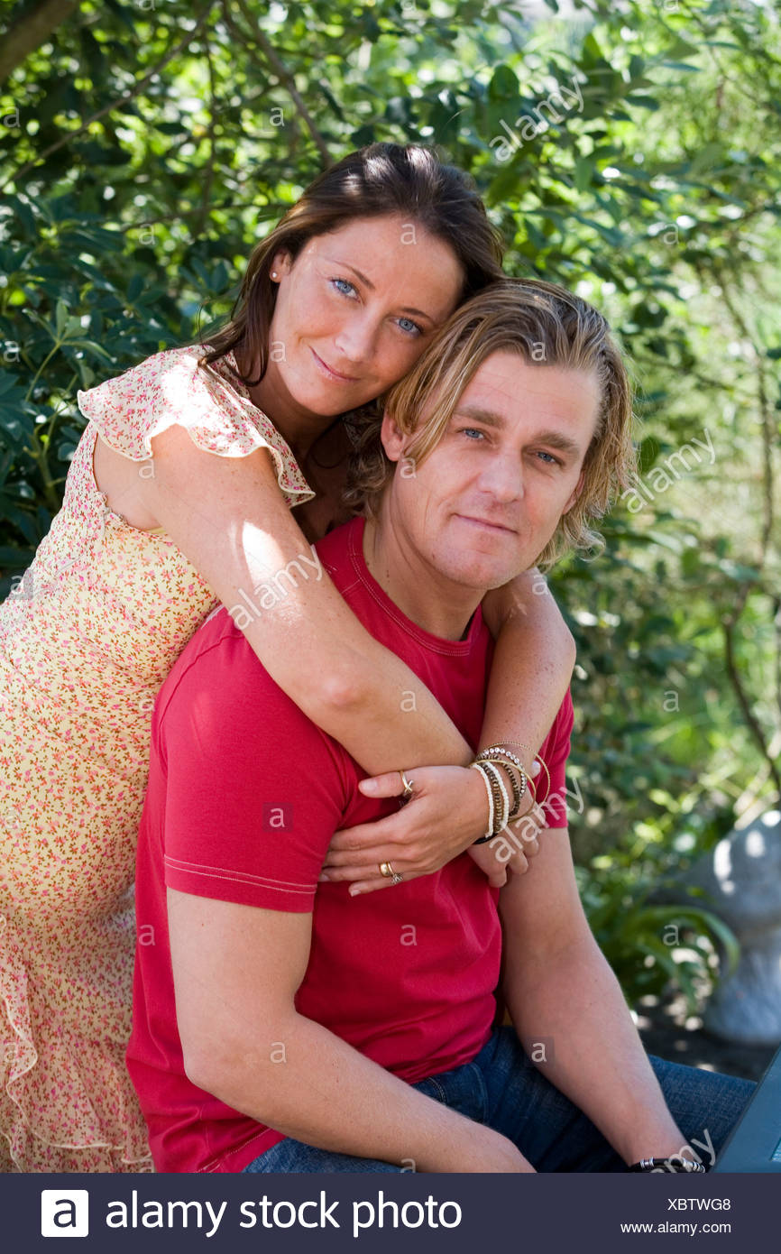 Woman hugging a man Photo Stock