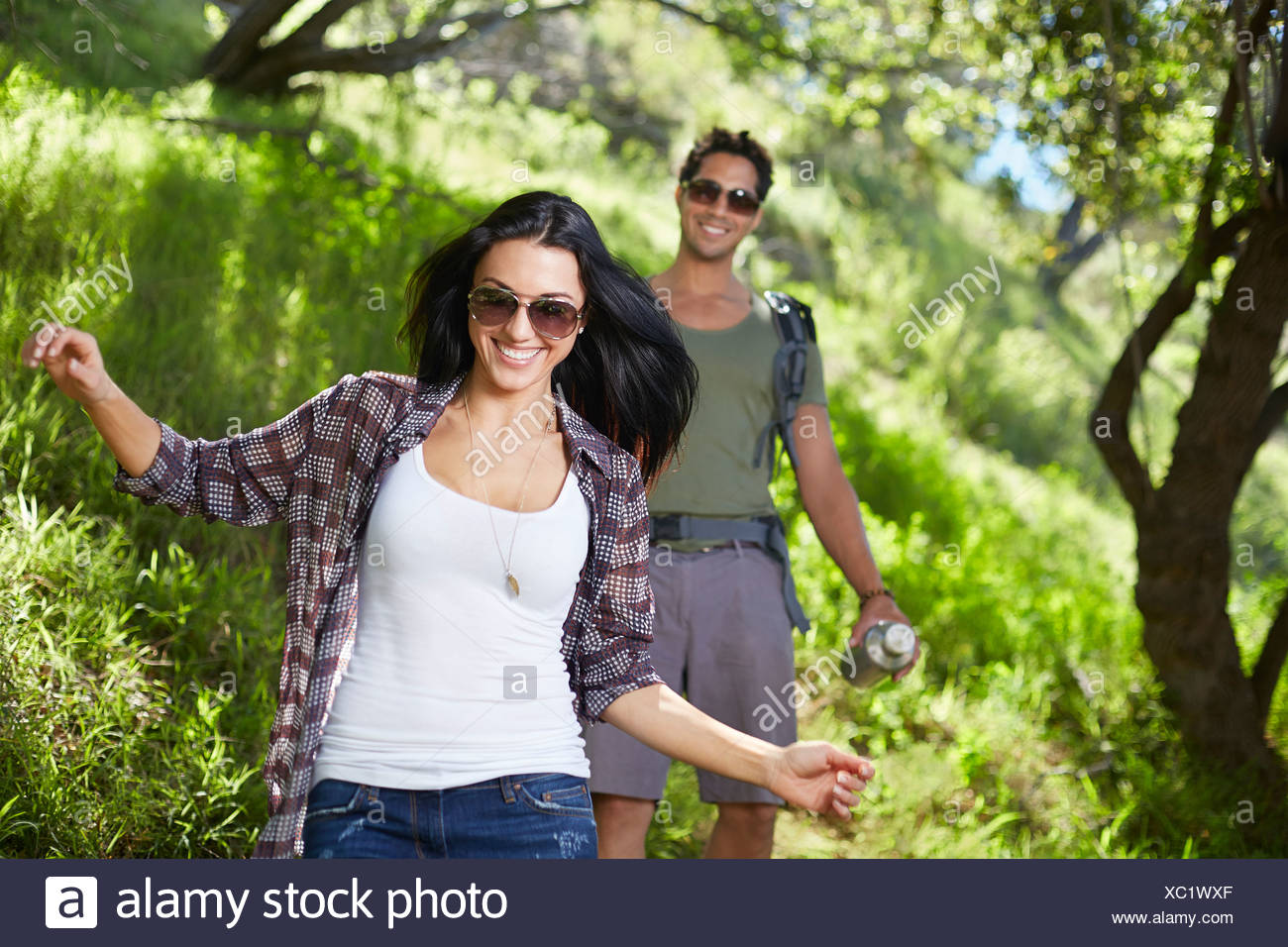 Smiling couple walking in woodlands Photo Stock