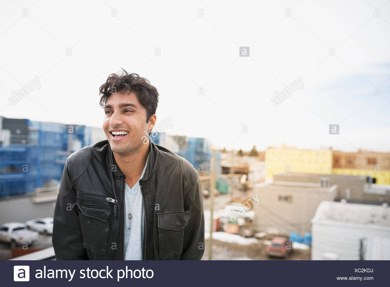 Laughing Man on urban rooftop Photo Stock