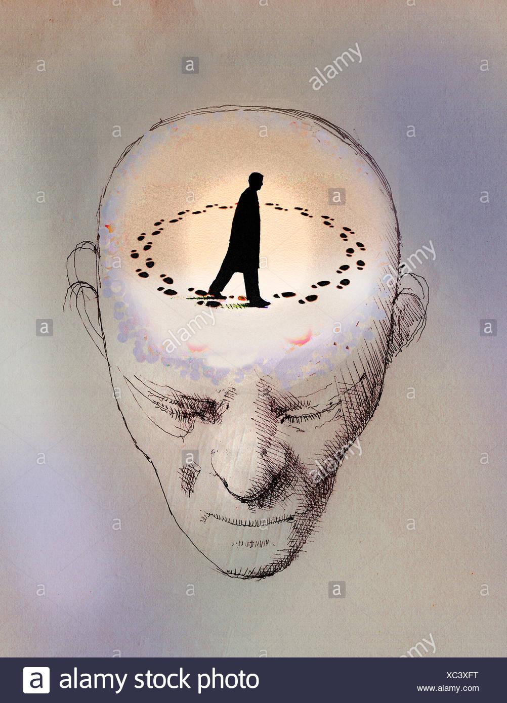 L'homme anxieux en rond à l'intérieur de la tête Photo Stock