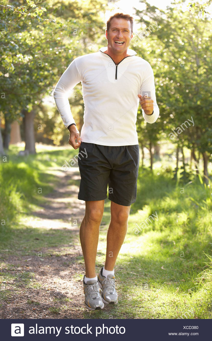 Middle aged Man Jogging In Park Banque D'Images
