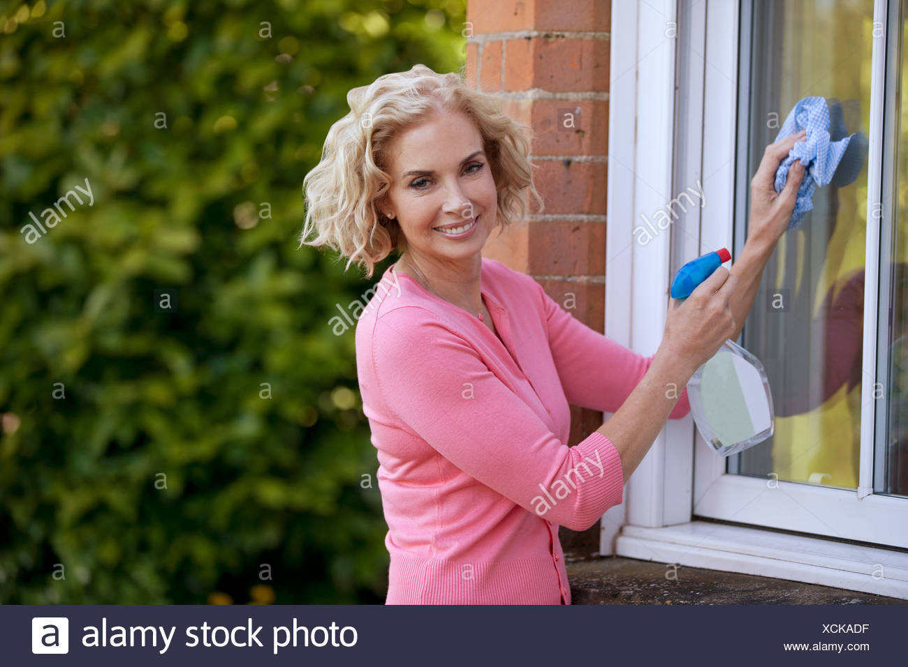 A mature woman cleaning Photo Stock