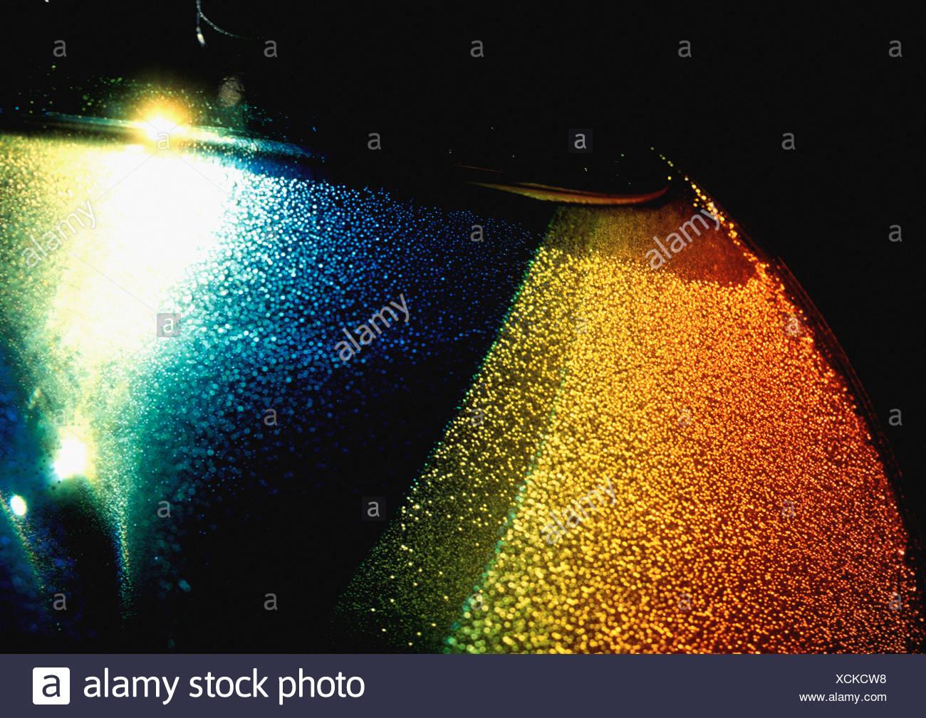 Effet de lumière texturés, jaune, bleu et rouge. Photo Stock