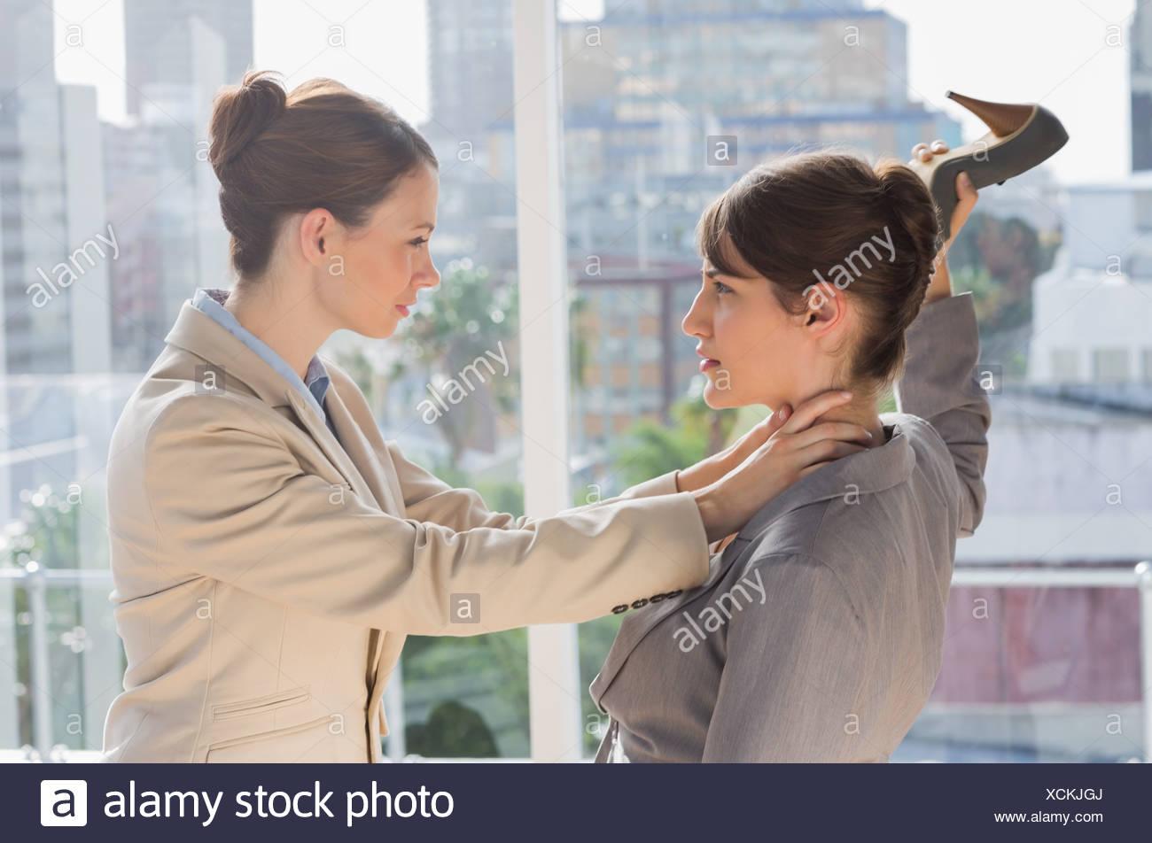 Businesswomen having un violent combat Photo Stock