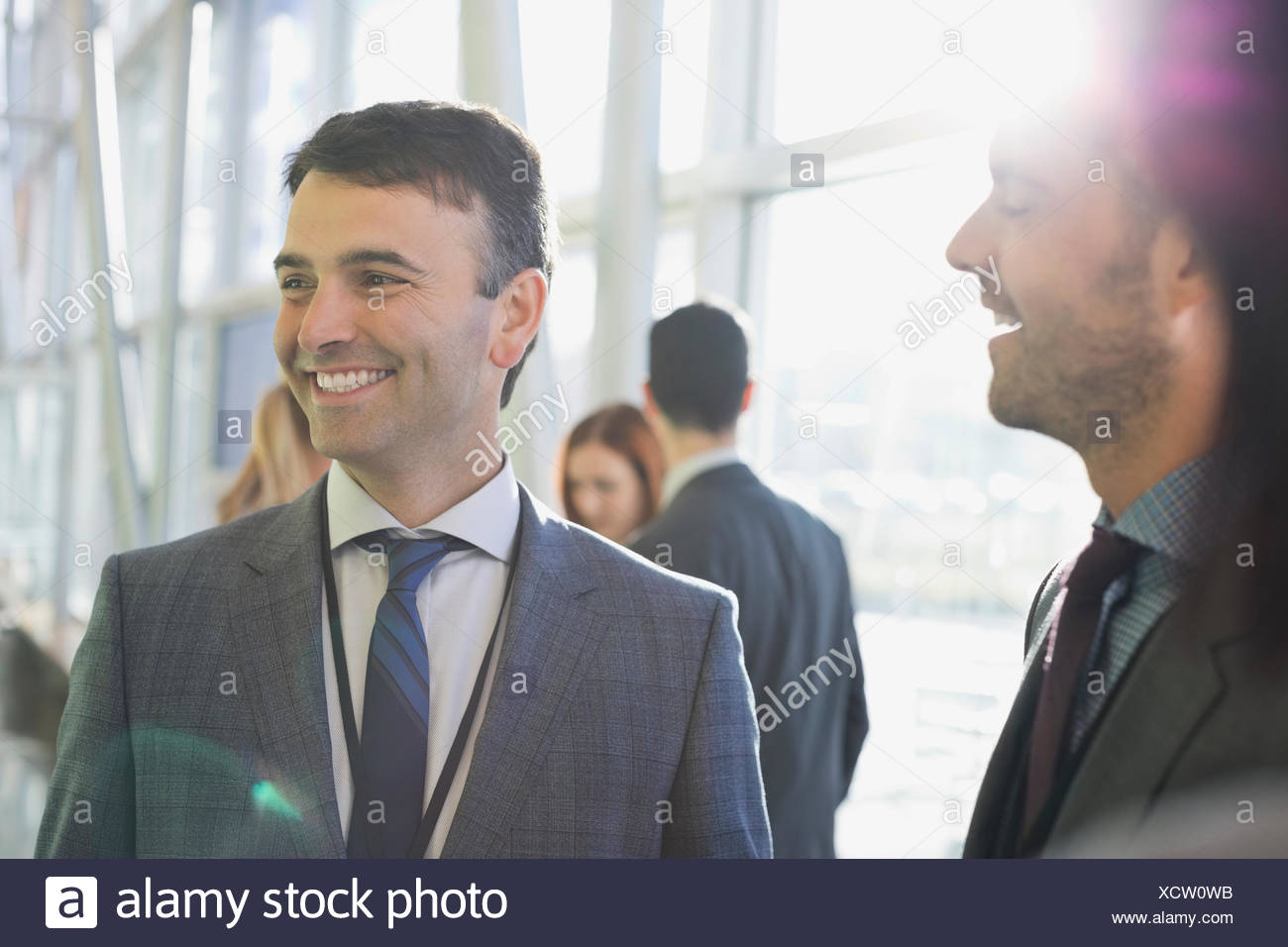 Businessmen smiling in lobby Photo Stock