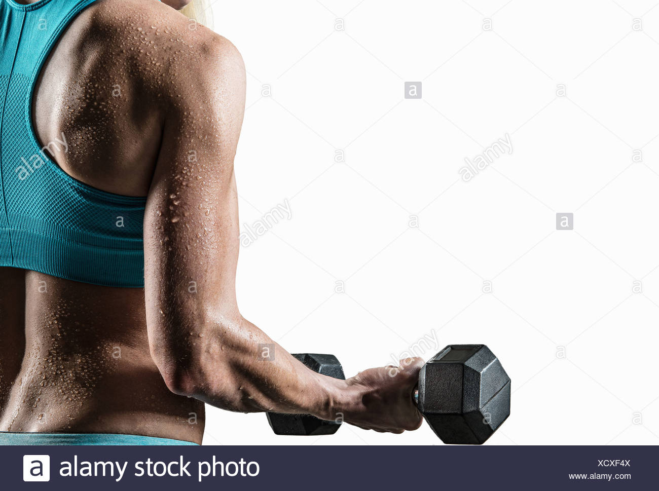 Jeune femme effectuant des biceps, Close up Photo Stock