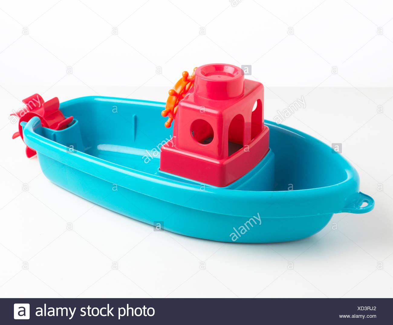 Bleu bateau jouet en plastique Photo Stock