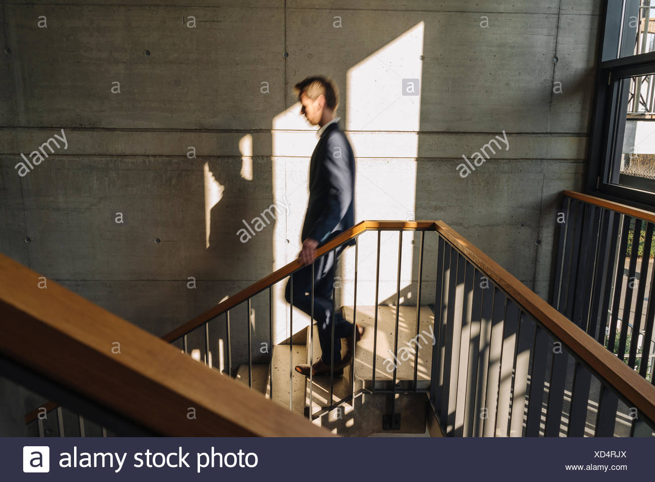 Businessman walking down stairs Photo Stock