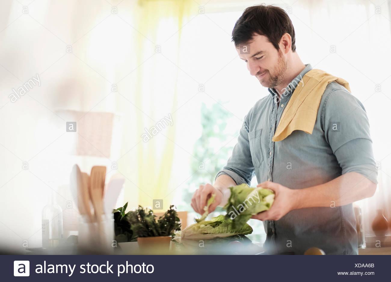 Man preparing food in kitchen Photo Stock