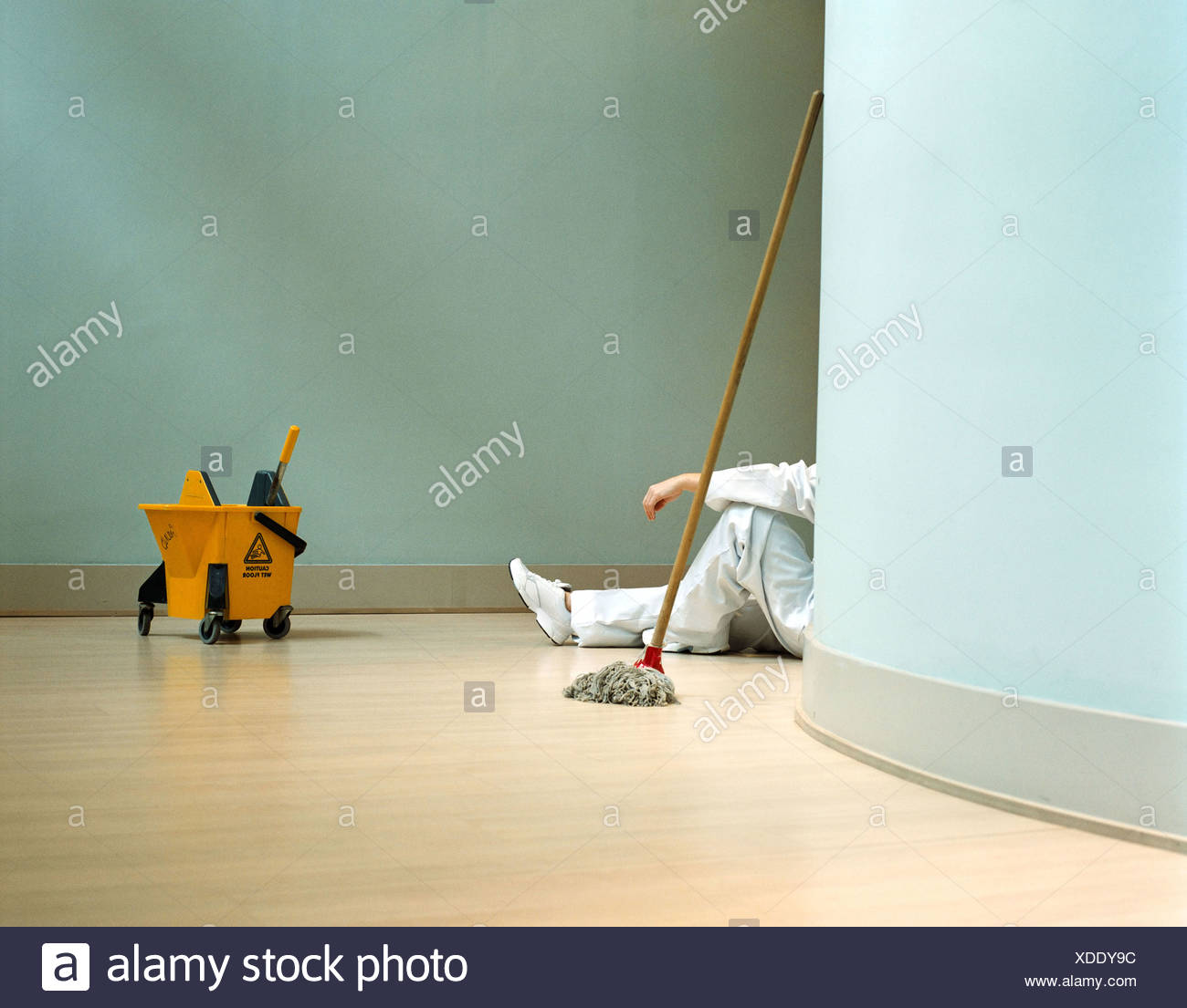 Cleaner relaxing in office Photo Stock