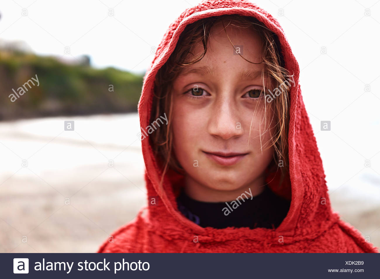 Portrait of Girl in red hooded top Photo Stock