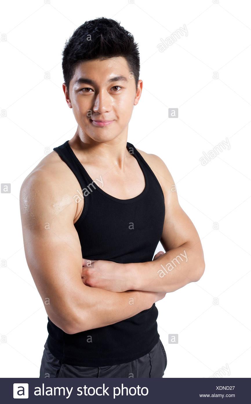 L'homme musclé avec les bras croisés Photo Stock