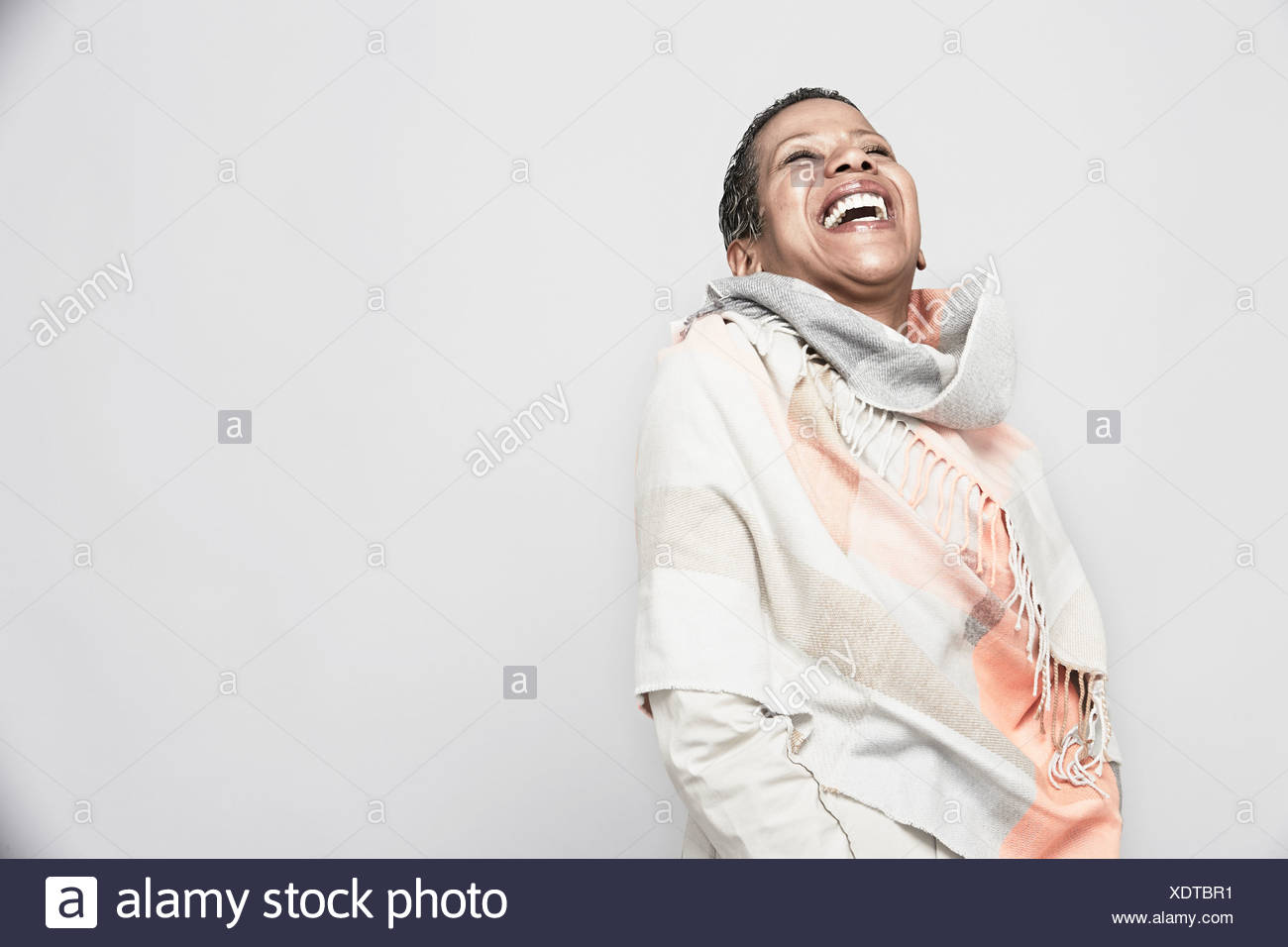 Studio portrait of young woman laughing Photo Stock