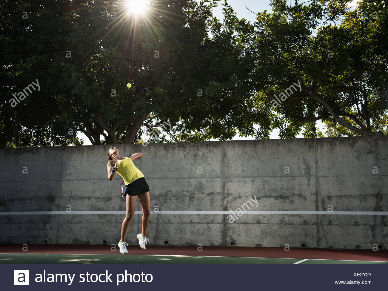 Tennis player hitting ball Photo Stock