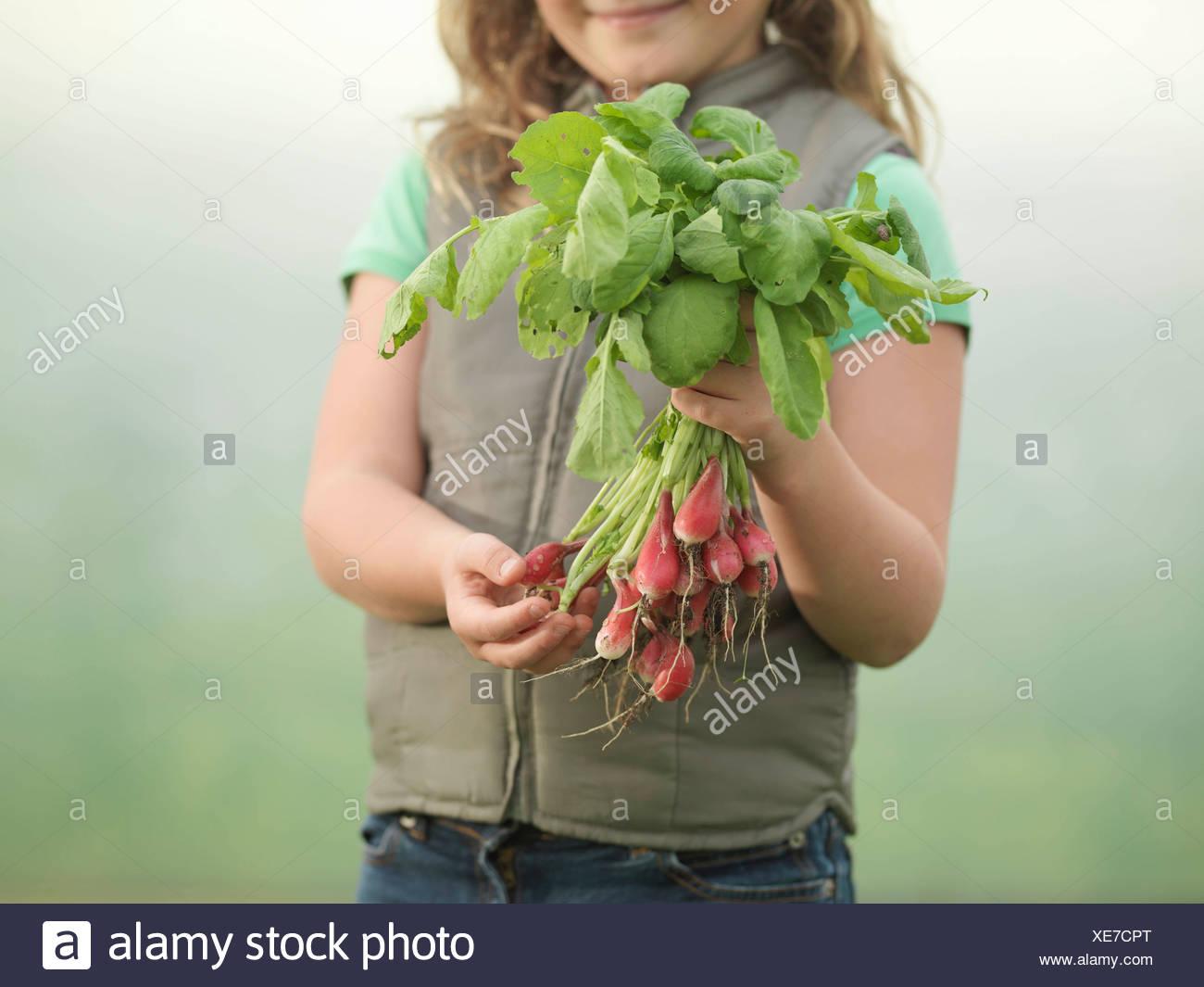 Girl Holding Radishes Photo Stock