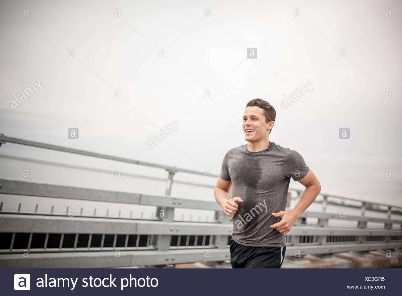 Young man jogging Photo Stock