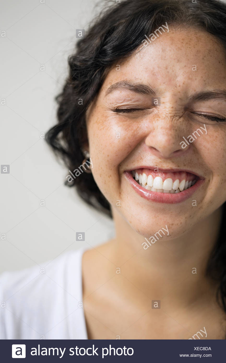 Close up of enthusiastic woman with eyes closed Photo Stock