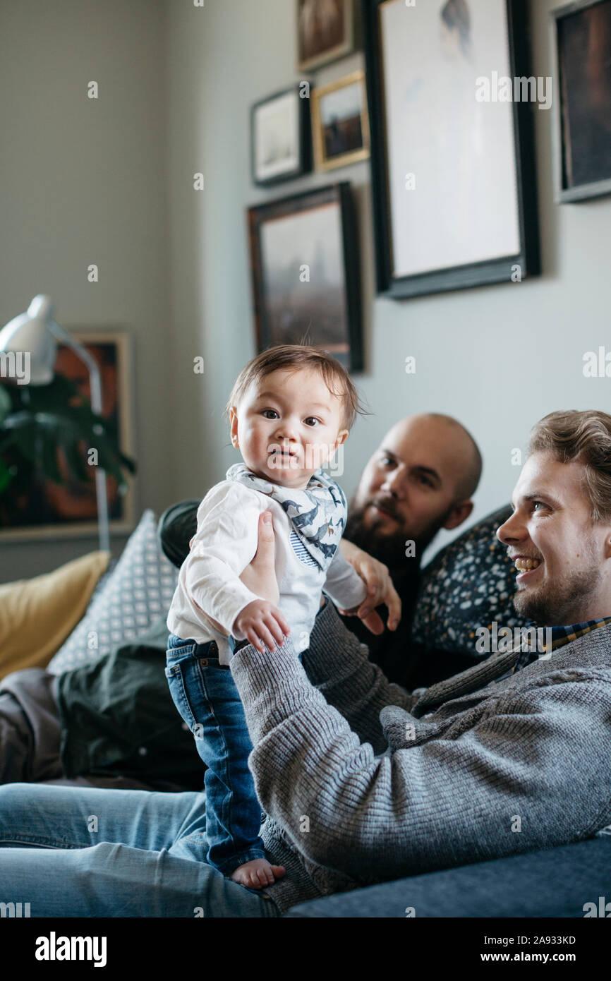 I genitori con bambino Foto Stock
