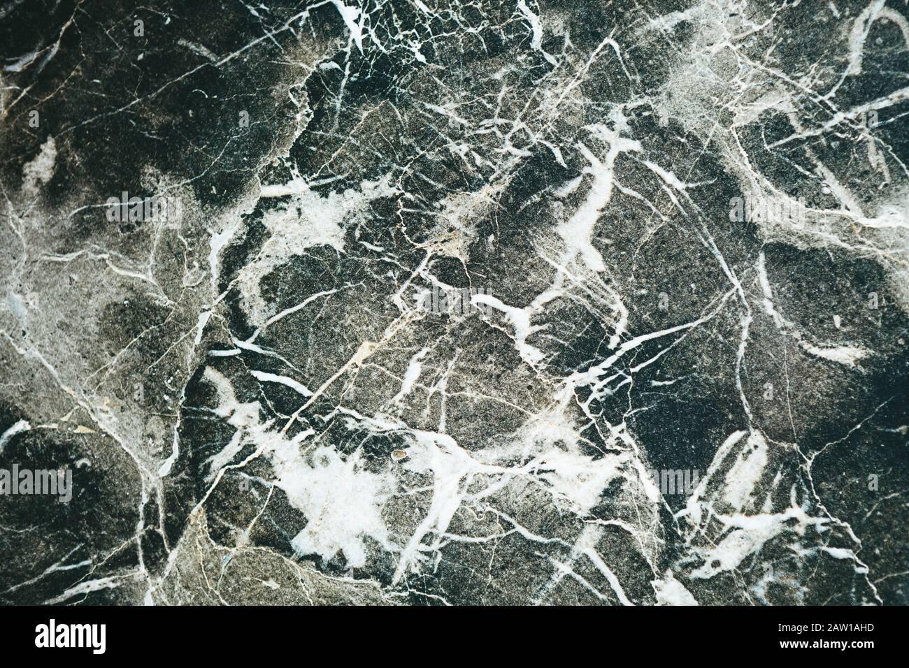 Naturale di marmo scuro dello sfondo astratto o uno sfondo Foto Stock