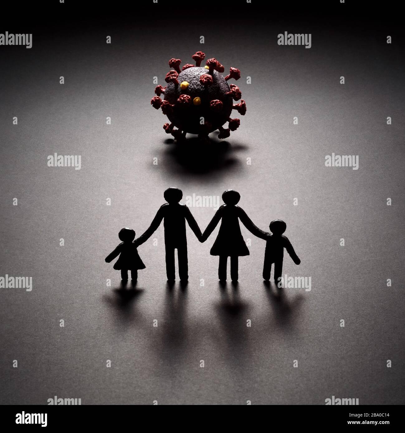 Minaccia dal nuovo Coronavirus. La pandemia COVID-19 è una sfida per ogni famiglia. Interdipendenza umana Foto Stock
