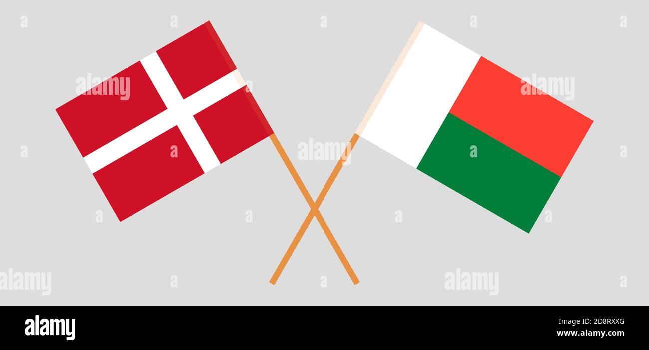 Bandiere incrociate del Madagascar e della Danimarca. Colori ufficiali. Proporzione corretta. Illustrazione vettoriale Illustrazione Vettoriale