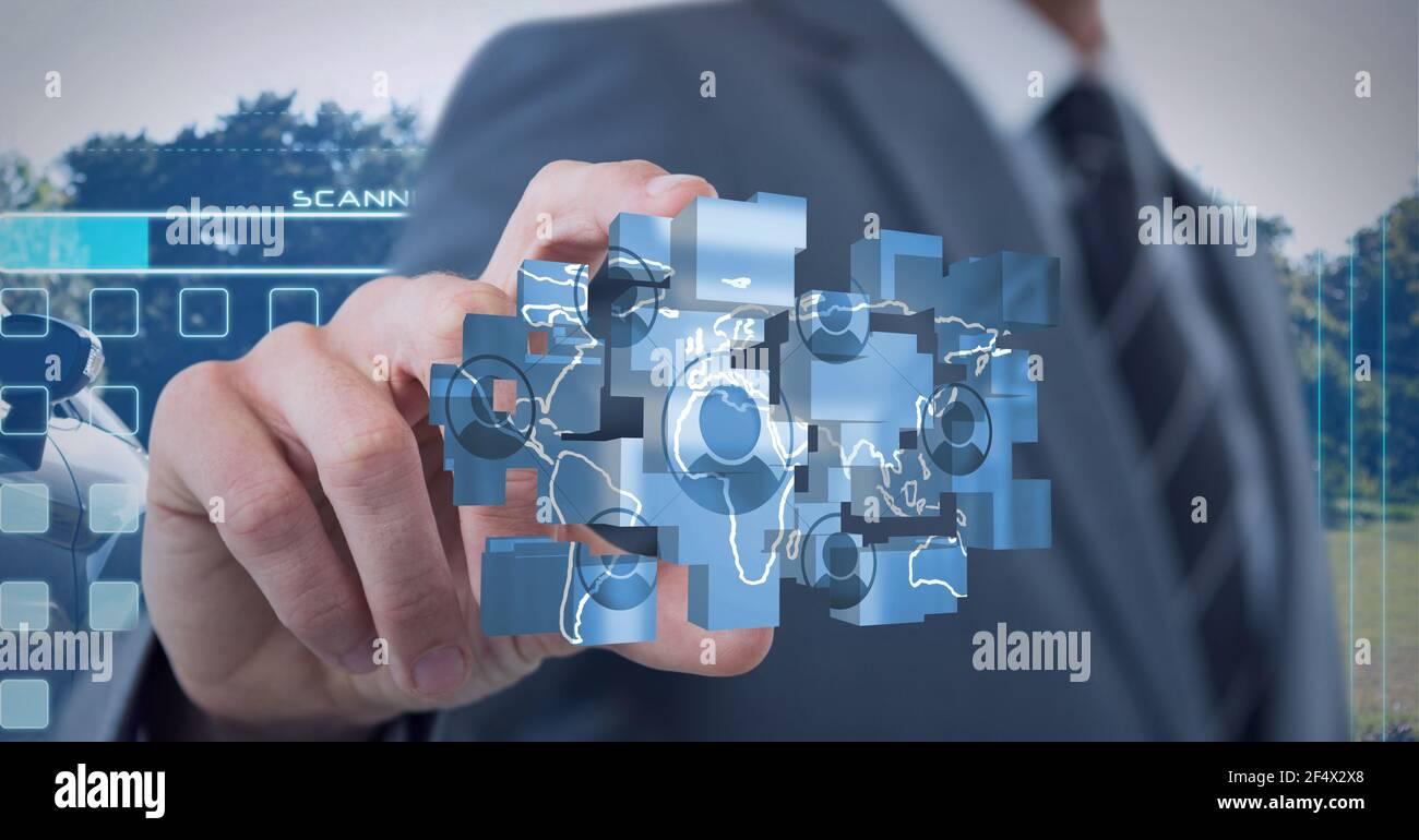 Composizione di un imprenditore che detiene una rete di icone digitali Foto Stock
