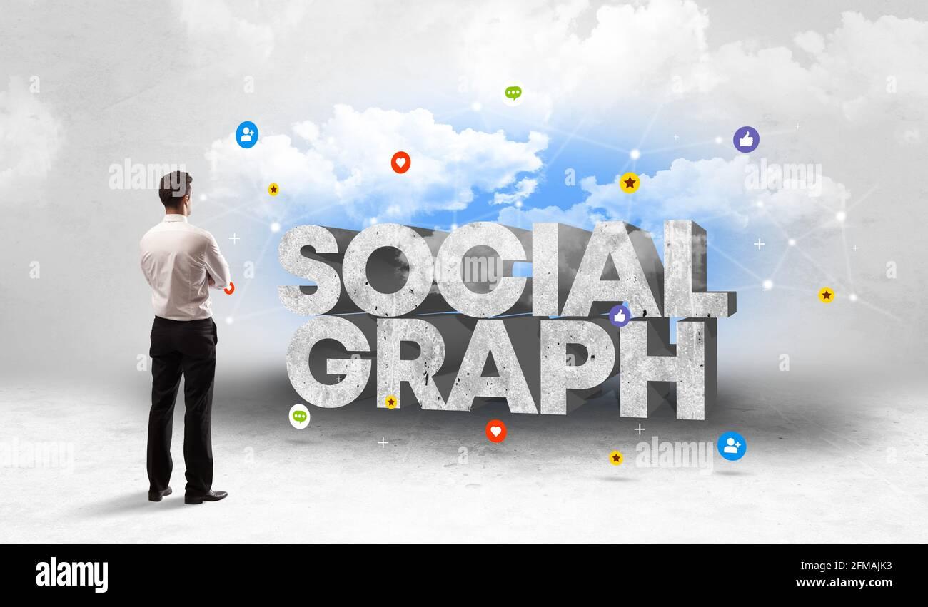 Giovane uomo d'affari di fronte ai social media Foto Stock