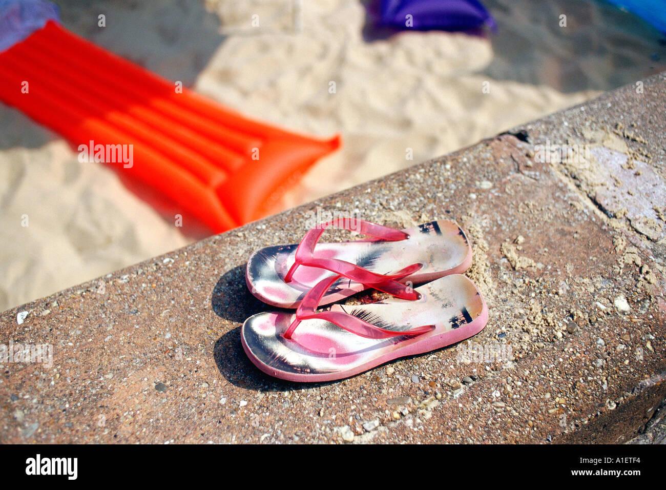Flip-flop sulla spiaggia Foto Stock