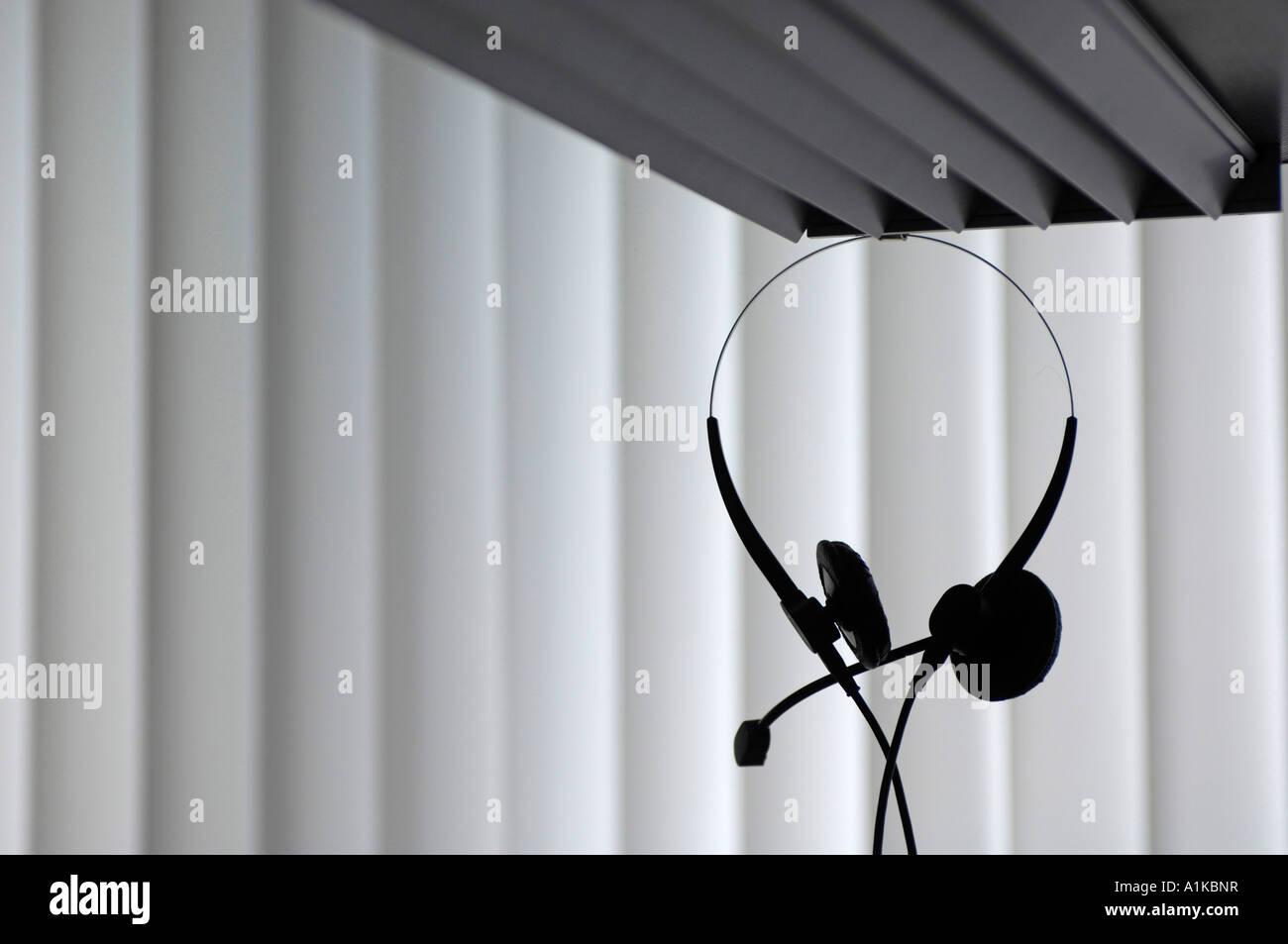 Il supporto tecnico. Cuffia telefonica in un ufficio Immagini Stock