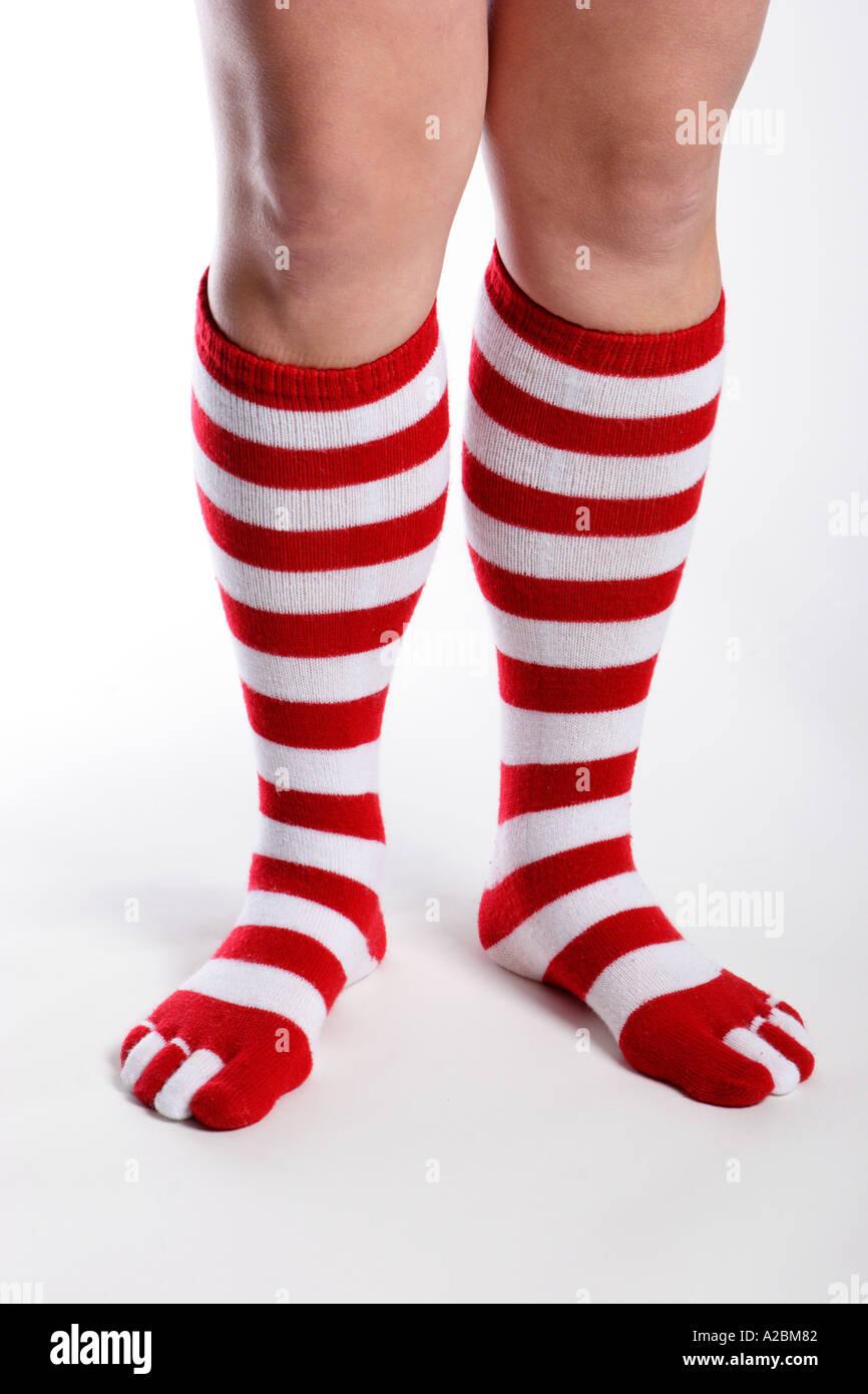 Il bianco e il rosso spogliato calze Foto Stock