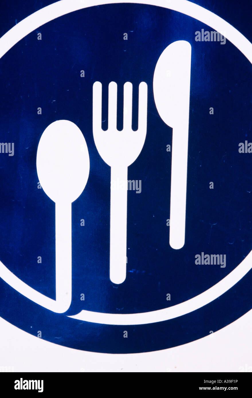Cartello, segnale, cibo, forcella, coltello, blu, bianco, indicazioni, close up Immagini Stock