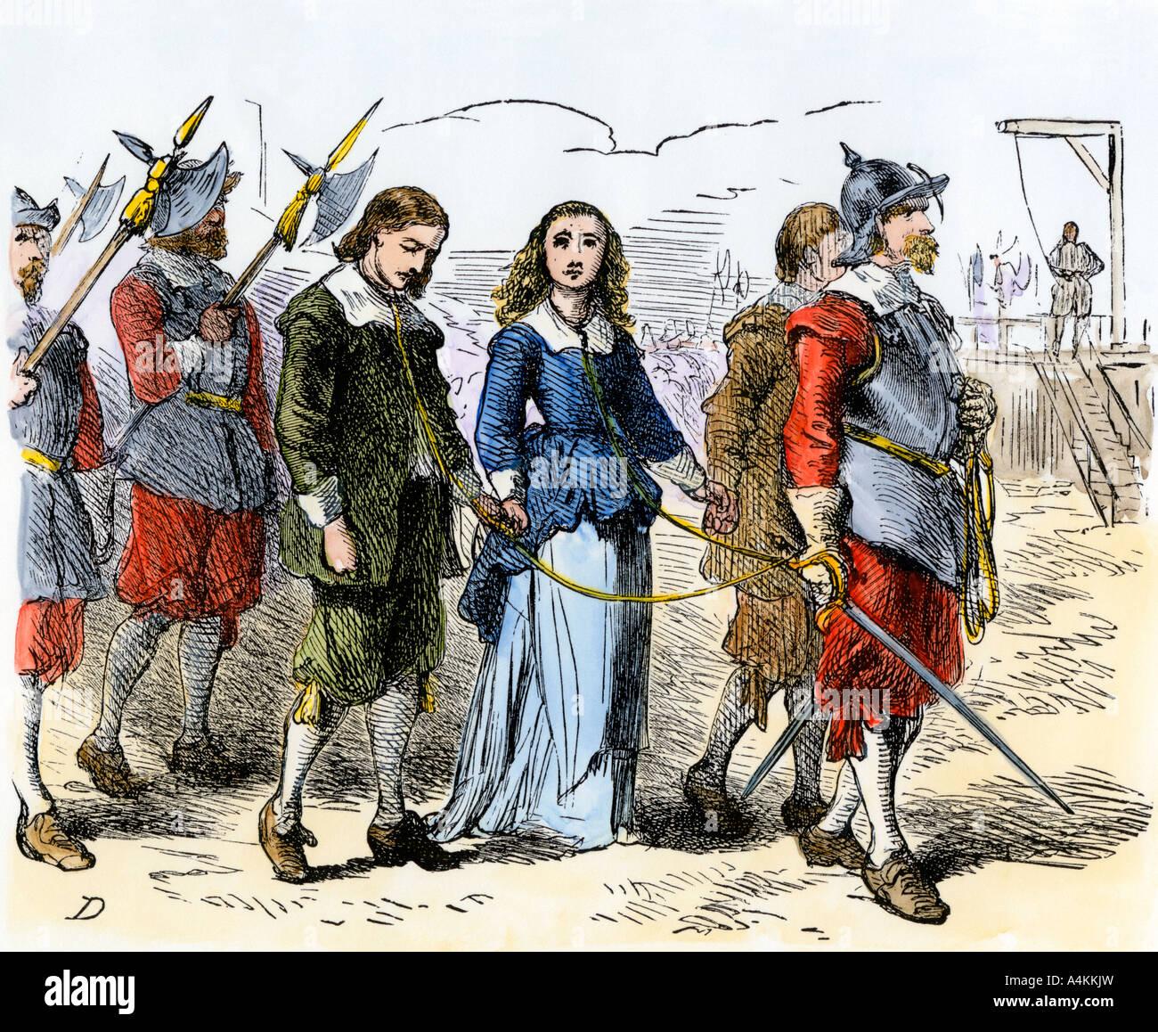 Quaccheri andando per la loro esecuzione in Puritan Massachusetts Bay Colony 1600s. Colorate a mano la xilografia Immagini Stock