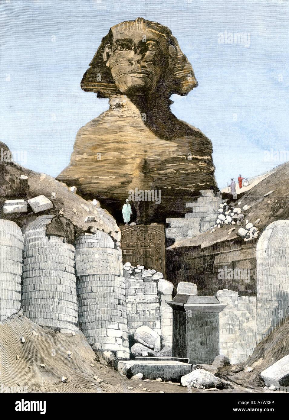 Lo scavo della Sfinge in corso a Ghizeh 1880. Colorate a mano la xilografia Immagini Stock