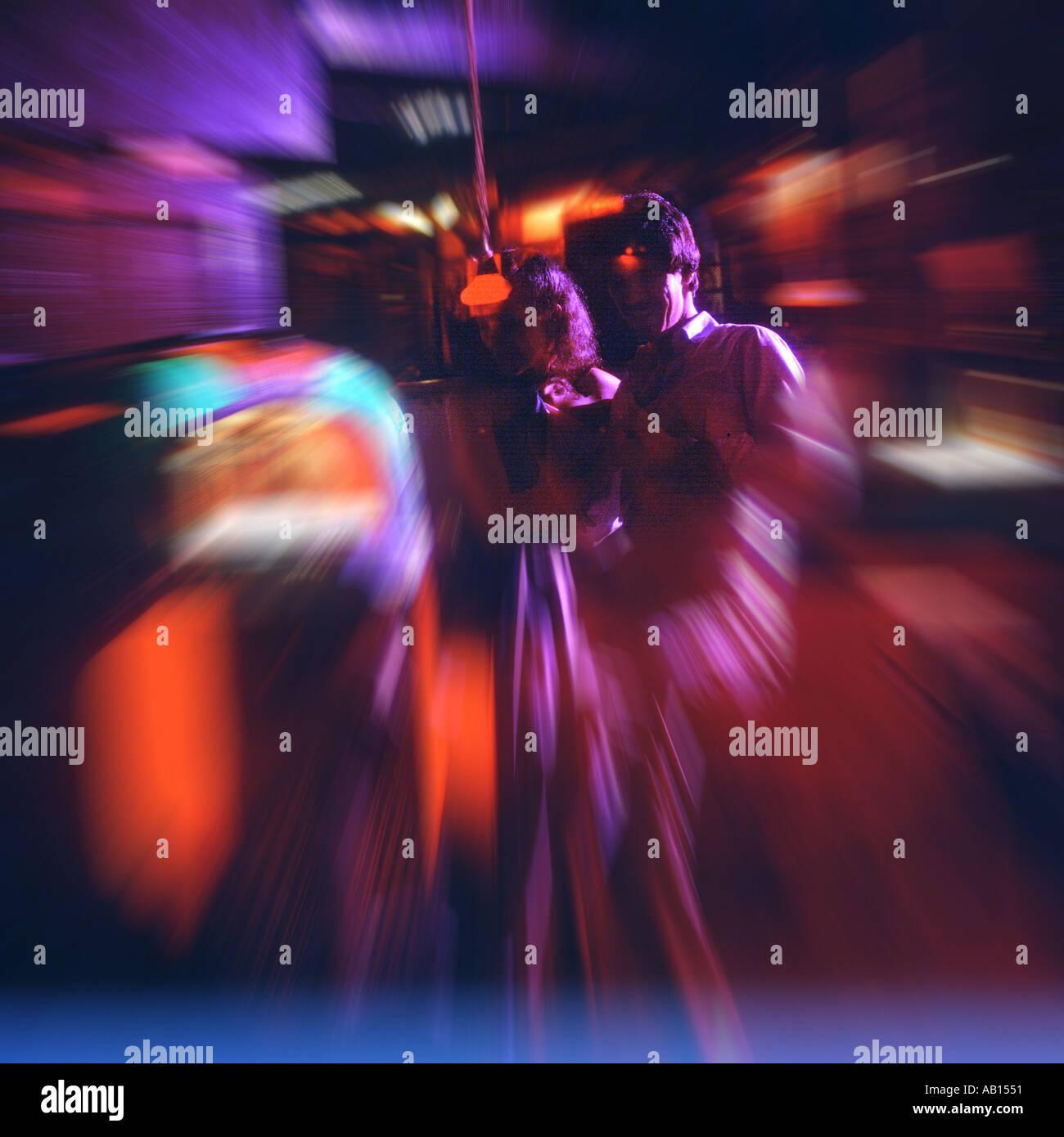 Coppia danzante in discoteca abstract Immagini Stock