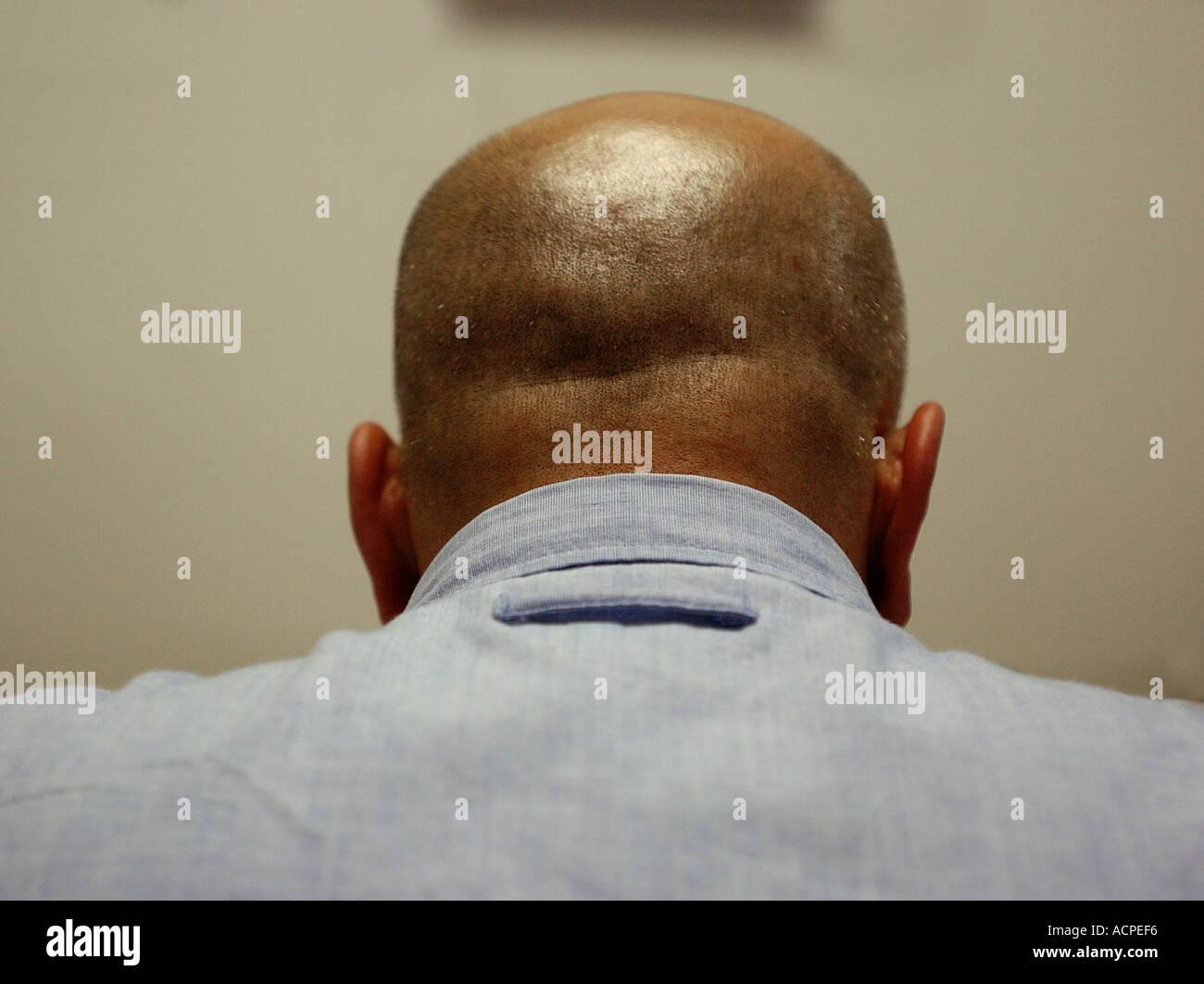 Ispanico uomo calvo dalla parte posteriore Immagini Stock
