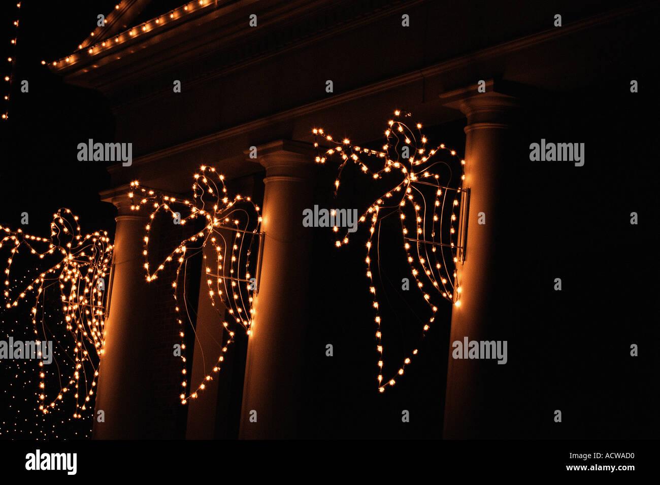 Angeli illuminato su colonna Immagini Stock