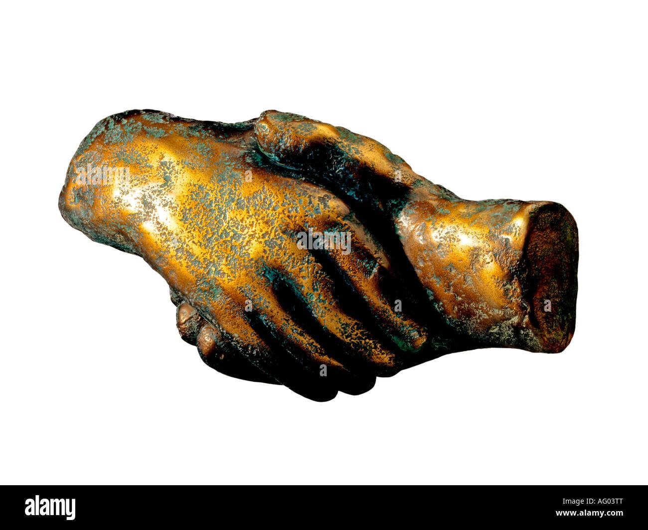 GOLDEN O IN FATTO di handshake in bronzo della mano Immagini Stock