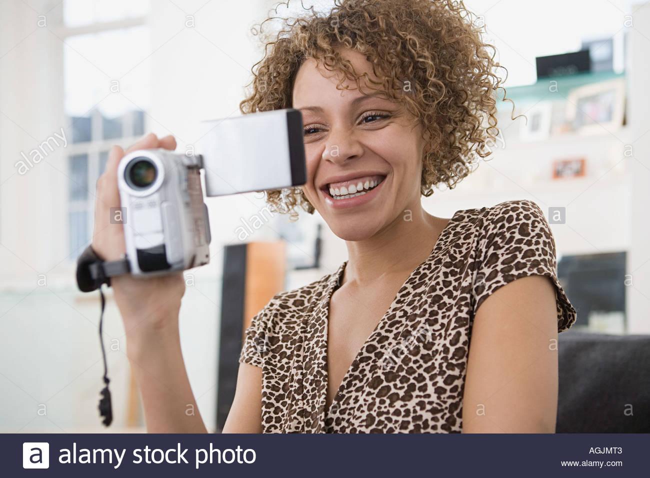 Donna con videocamera Immagini Stock