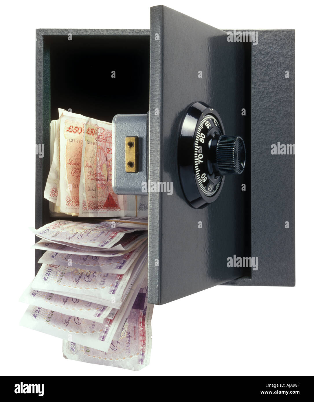 Cassaforte con combinazione di comporre con denaro versando il Immagini Stock