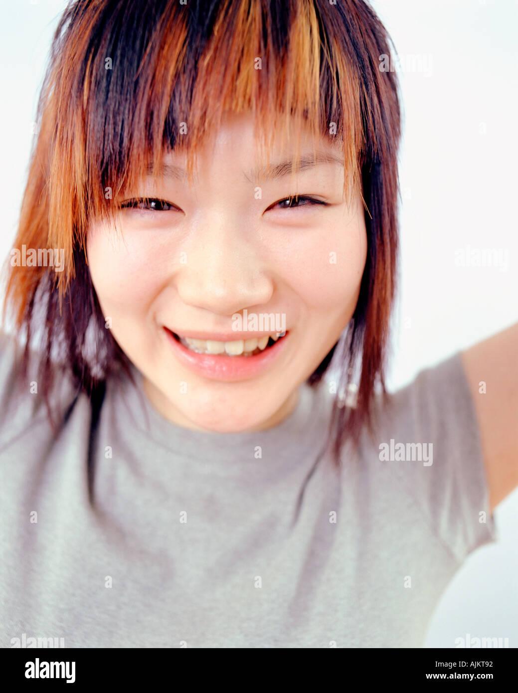 Giovani Oriental donna sorridente Immagini Stock