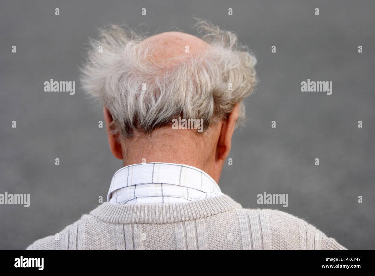 Vista posteriore di anziani balding man Immagini Stock