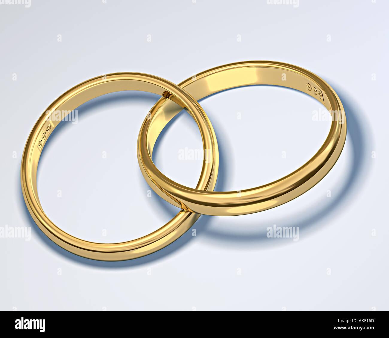 Due anelli di oro asserviti simbolo del matrimonio matrimonio collegamento rapporto di fusione Immagini Stock