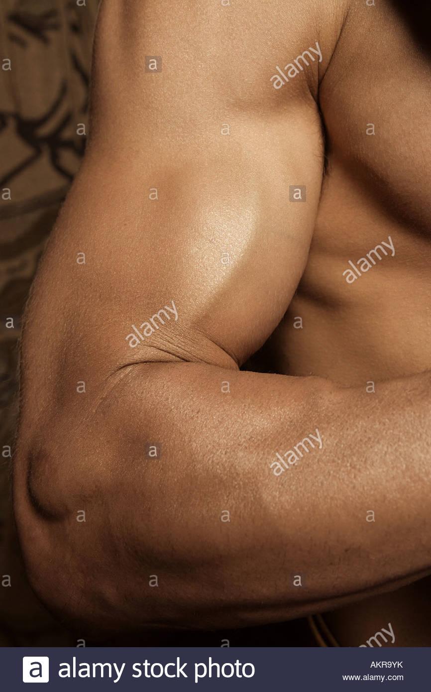 Braccio muscoloso Immagini Stock